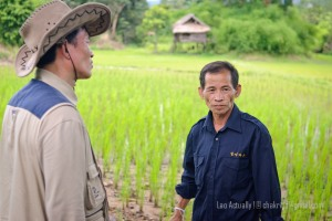 An official from the Lao government's Water Resources and Environment Authority talks to a farmer in the Nam Ngiep 1 project area during a consultation and inspection mission in August 2011.